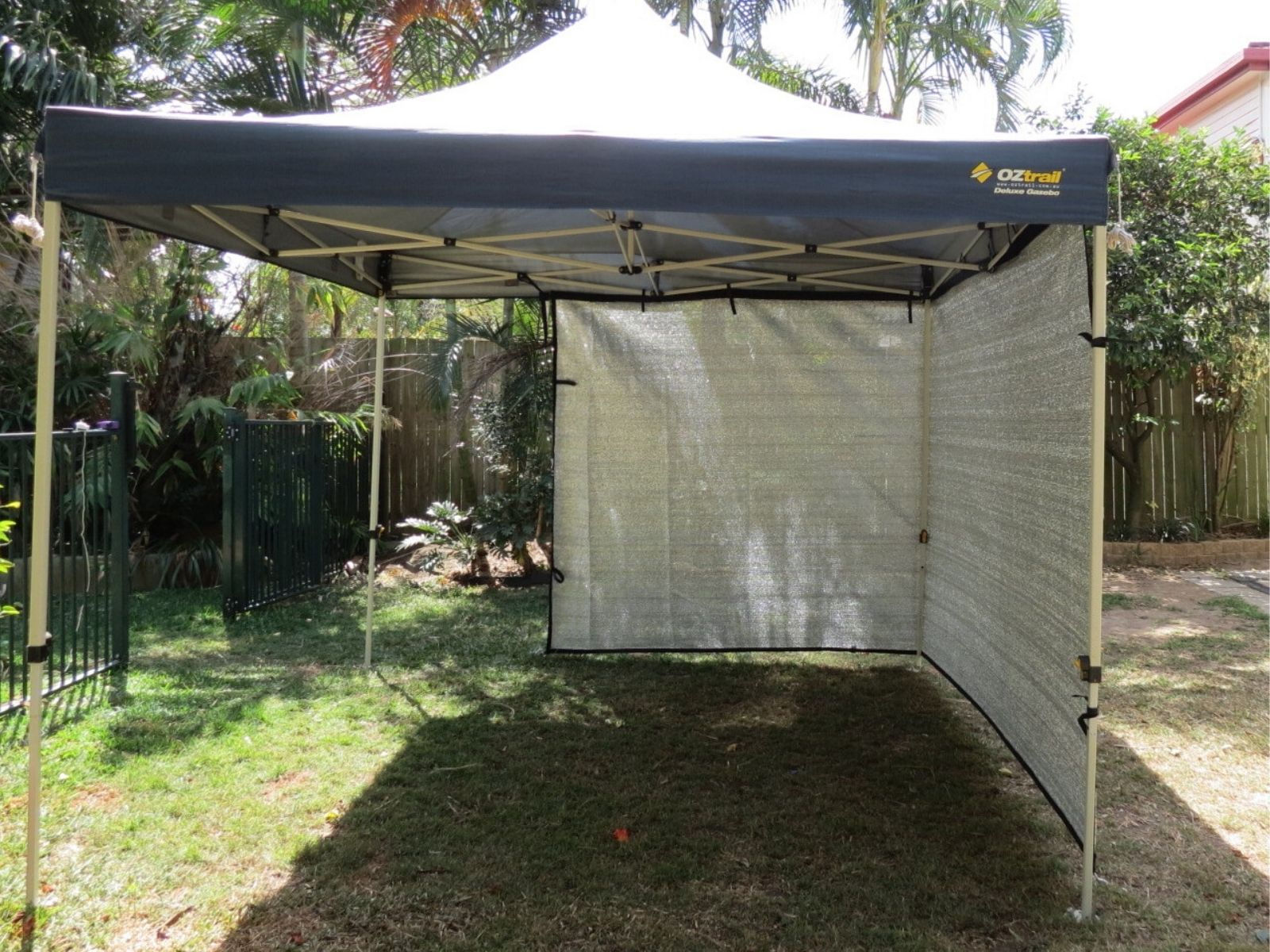 3m Gazebo with 4.9m x 2m Cool Shade wall wrapped around sides to create protection from the sun