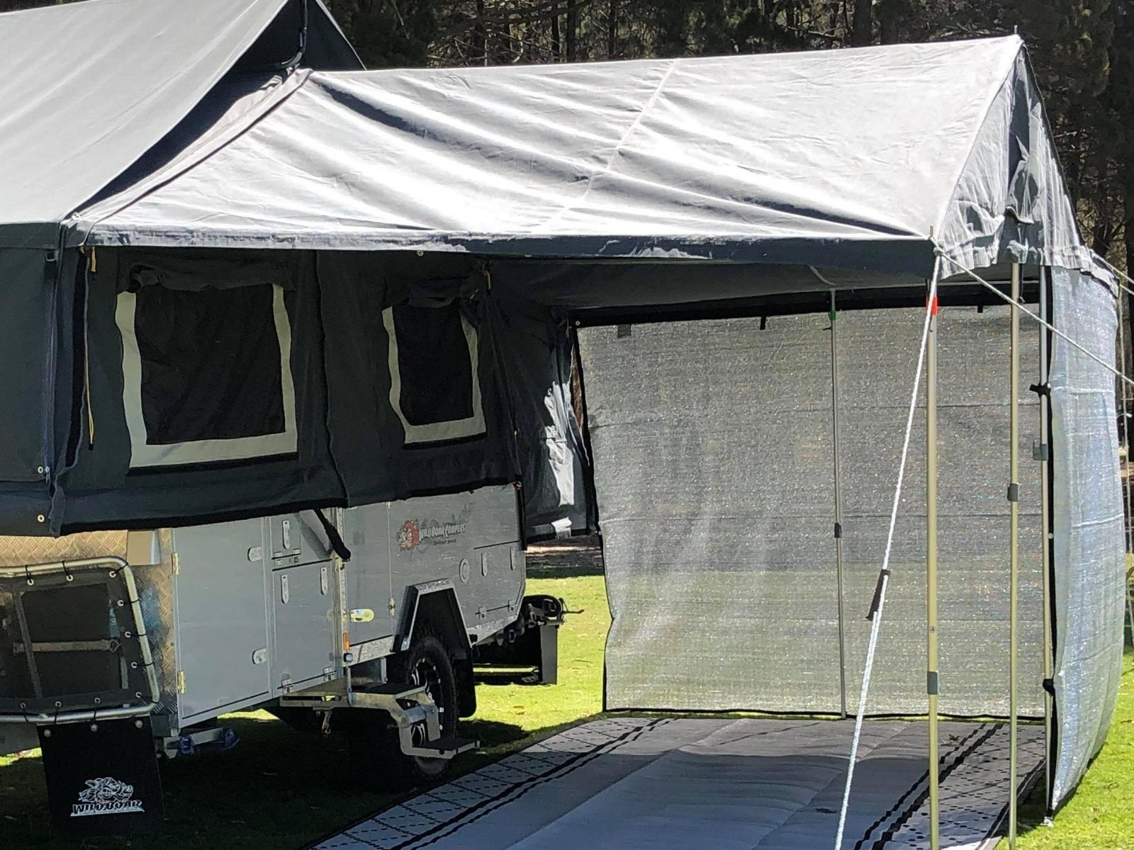 6m Camper Trailer shade screen wraps around the awning creating a screen room